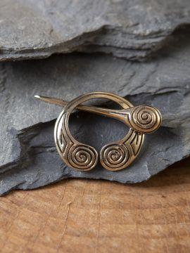Fibule celtique avec motif en spirale